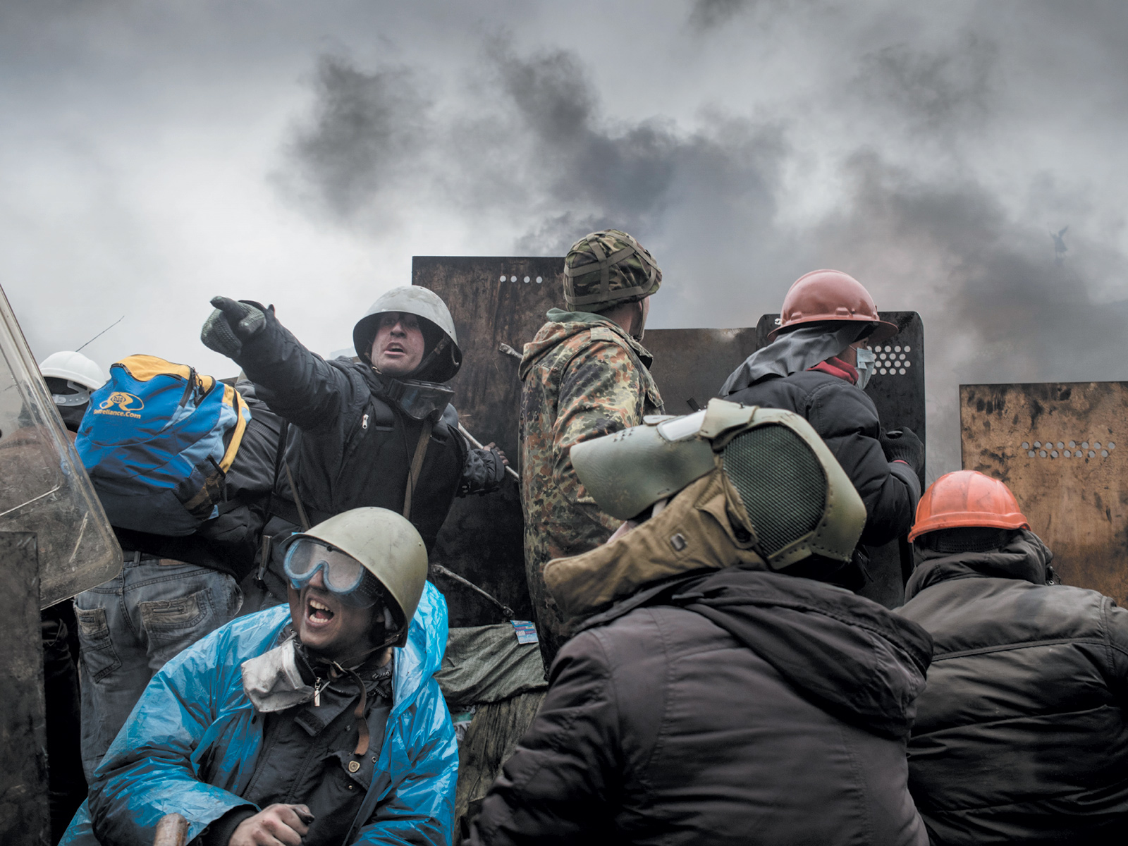 Unarmed anti-government protesters being fired upon by snipers, Maidan Square, Kiev, February 2014