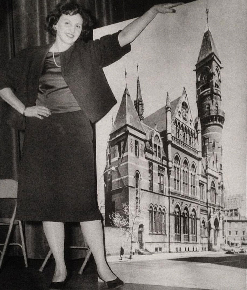 Margot Gayle in 1960 with a photo of Manhattan's Jefferson Market Courthouse, which she helped save from destruction. It is now a branch of the New York Public Library.