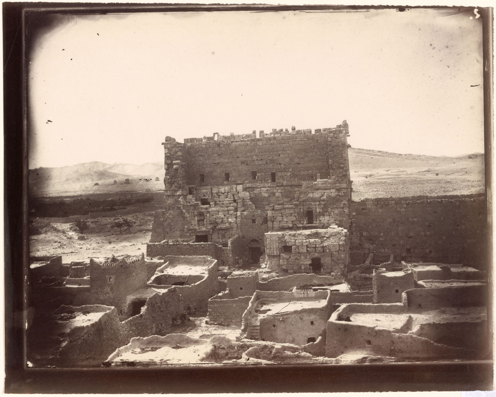 The gate of the courtyard of the Temple of Bel, Palmyra, photographed by Louis Vines, 1864