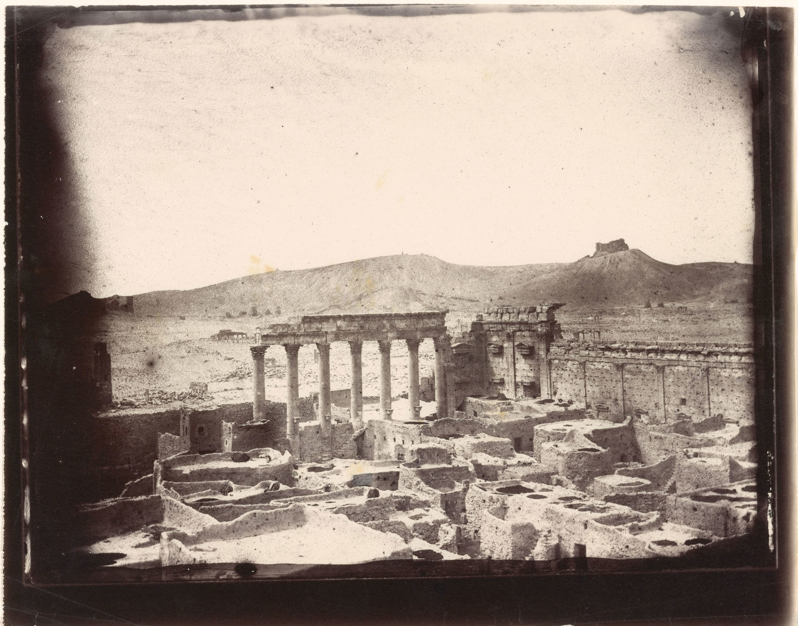 The northwest corner of the courtyard of the Temple of Bel, Palmyra, photographed by Louis Vines, 1864