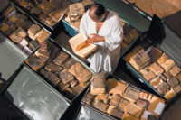 Abdel Kader Haidara in Timbuktu with ancient manuscripts from Mali, Niger, Ethiopia, Sudan, and Nigeria, September 2009. Haider was instrumental in saving the manuscripts during the militant Islamist takeover of Timbuktu in 2012.