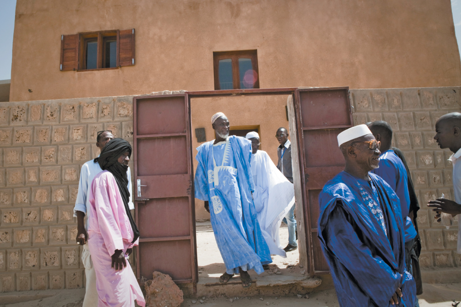 Community leaders leaving a ceremony honoring Timbuktu's Crisis Committee, formed the year before to mediate between the civilian population and the jihadists during the Islamist takeover, October 2013