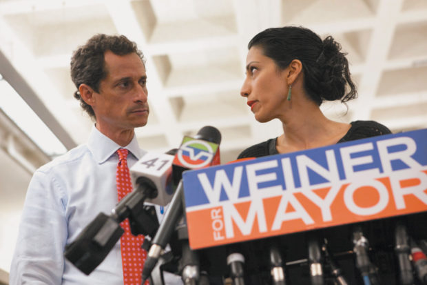 Anthony Weiner and Huma Abedin at the press conference announcing his intention to stay in New York's mayoral race despite new revelations about his explicit text messages to women sent after a similar scandal in 2011 that had forced him to resign from