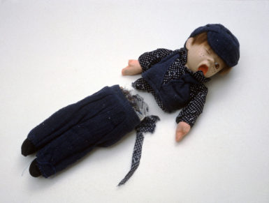 Cornelia Parker: Shared Fate (Oliver), doll cut in half by the guillotine that chopped off Marie Antoinette's head, 1998