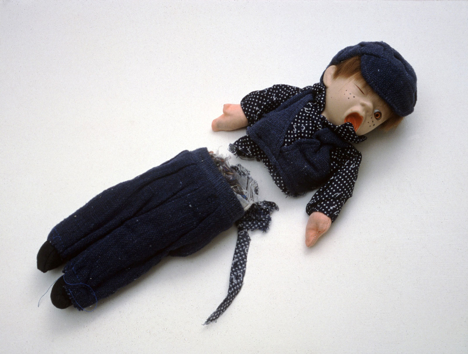 Cornelia Parker: <em>Shared Fate (Oliver)</em>, doll severed by the guillotine that was used on Marie Antoinette, 1998