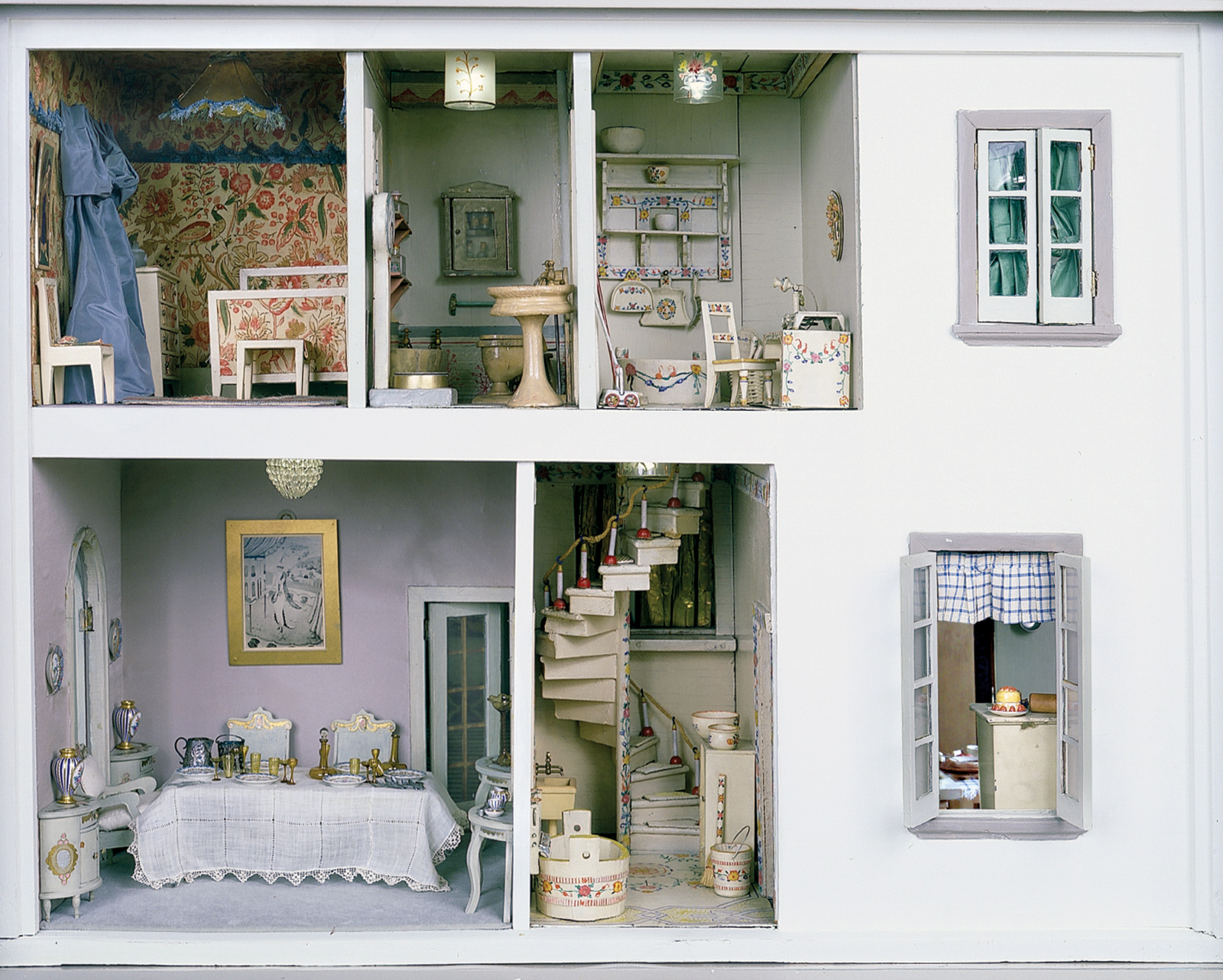 The left side of the Stettheimer Dollhouse, created by Carrie Walter Stettheimer, 1916–1935. Clockwise from top left are the Chintz Bedroom, the Green Bathroom, the Upper and Lower Backstairs, and the Dining Room; from The Stettheimer Dollhouse at the Museum of the City of New York, published by Pomegranate Communications.