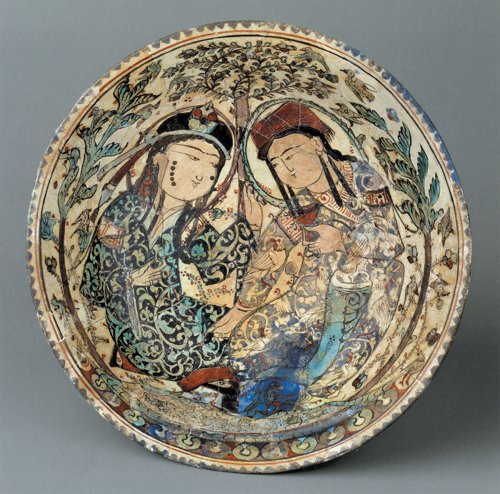 'Bowl with Couple in a Garden'; stonepaste plate, Iran, late twelfth–early thirteenth century