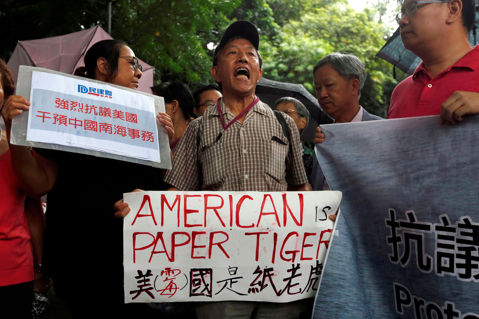 A protester chants slogans against the United States supporting an international court ruling that denied China's claims to the South China Sea, outside US Consulate in Hong Kong, China, July 14, 2016