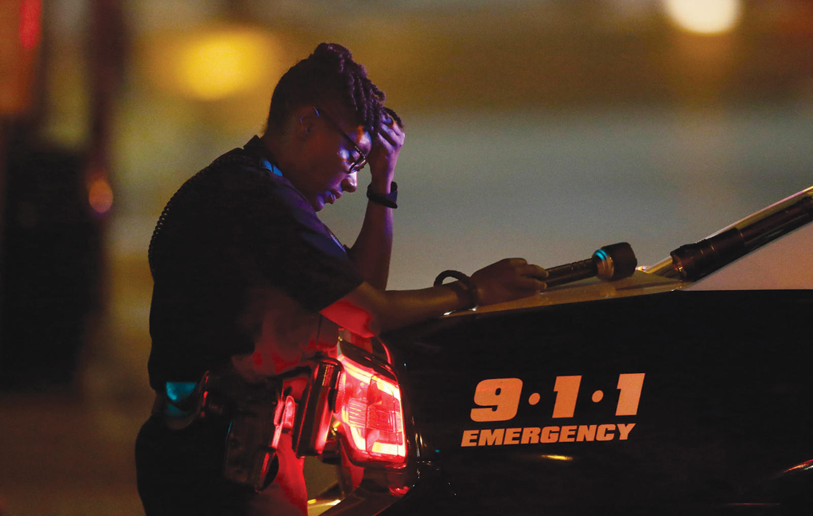 A police officer in downtown Dallas after the shootings that killed five of her fellow officers during the Black Lives Matter march, July 8, 2016