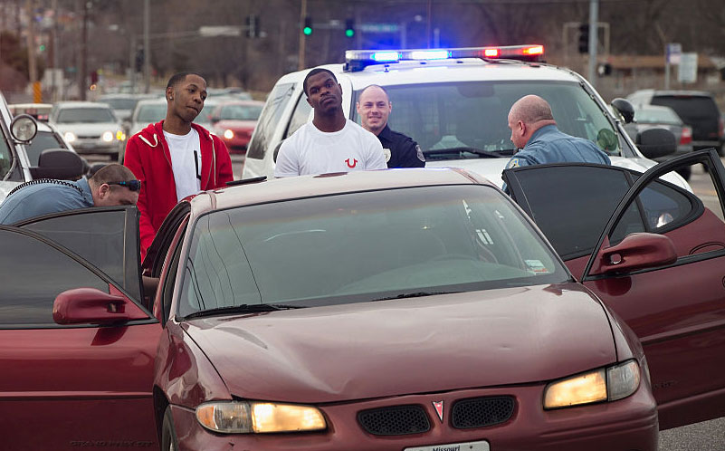 Police search a vehicle, Ferguson, Missouri, March 14, 2015