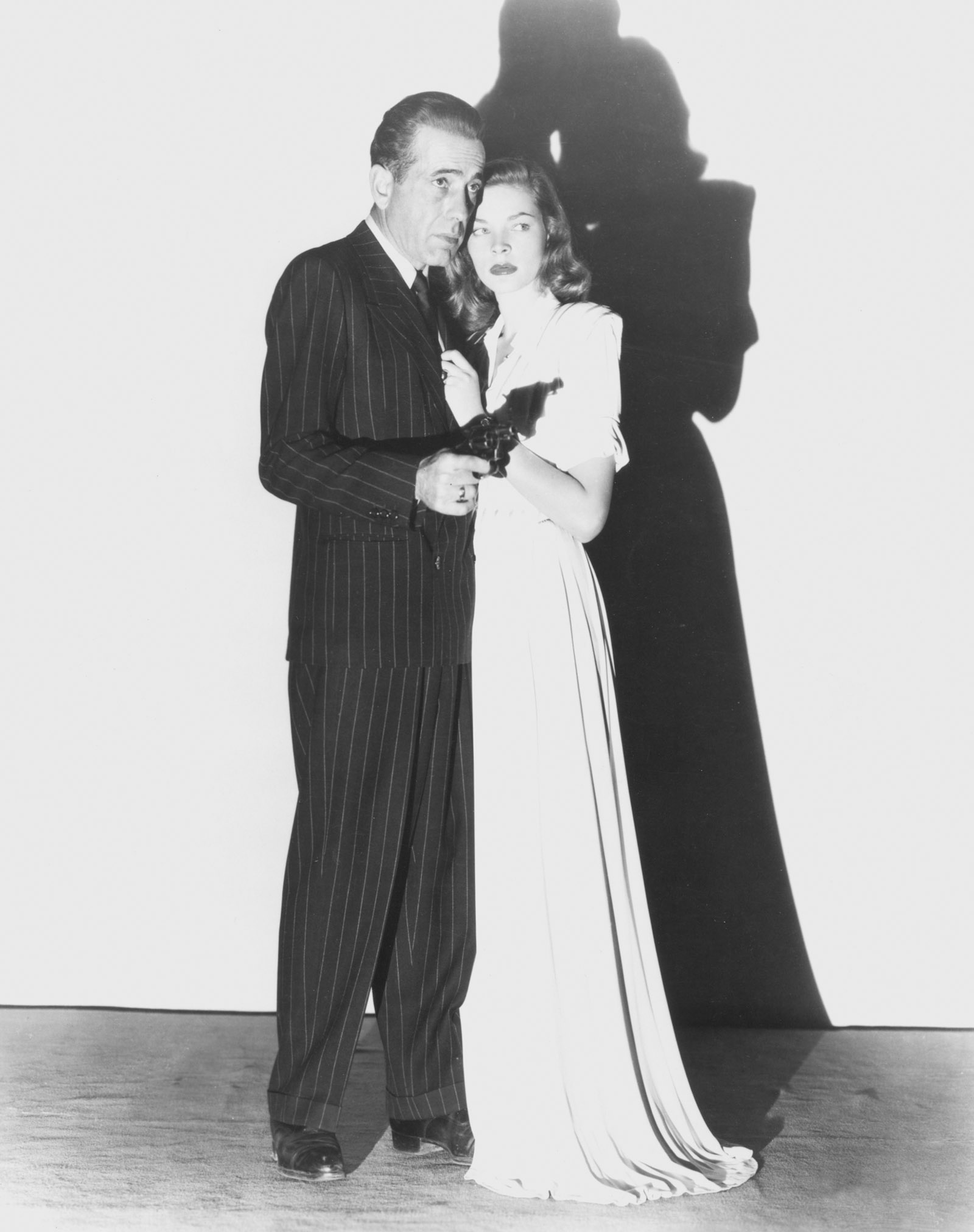Humphrey Bogart and Lauren Bacall in a publicity photograph for the film adaptation of Raymond Chandler's The Big Sleep, 1946