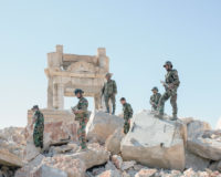 Syrian Army soldiers at the ruins of the destroyed Temple of Bel after retaking the ancient city of Palmyra from Islamic State militants, April 2016