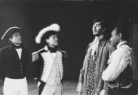 A scene from the first production of Robert Lowell's Benito Cereno, part of his trilogy, The Old Glory, directed by Jonathan Miller at the American Place Theater in 1964 and based on Herman Melville's novella. Captain Amasa Delano (Lester Rawlins, second from left), who has boarded the slave ship San Dominick off the coast of Trinidad, is listening to its captain, Don Benito Cereno (Frank Langella), and is still unaware that the slaves, under the command of Cereno's servant, Babu (Roscoe Lee Browne, right), have taken over the ship.