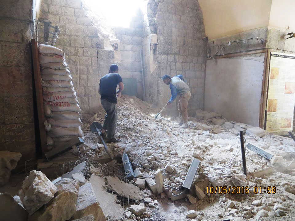 The mosaic museum in Ma'arrat al-Numan, northwestern Syria, following an airstrike by the Syrian government in May 2016; mosaics at left were protected by a wall of sandbags