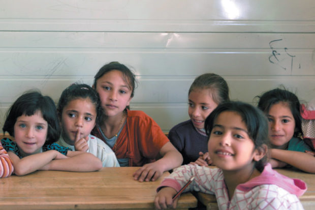 Syrian children at a school in the Zaatari refugee camp, near Mafraq, Jordan, April 2016. Several members of the staff receive pay through UNICEF's cash-for-work program, managed by the United Nations Office for Project Services.