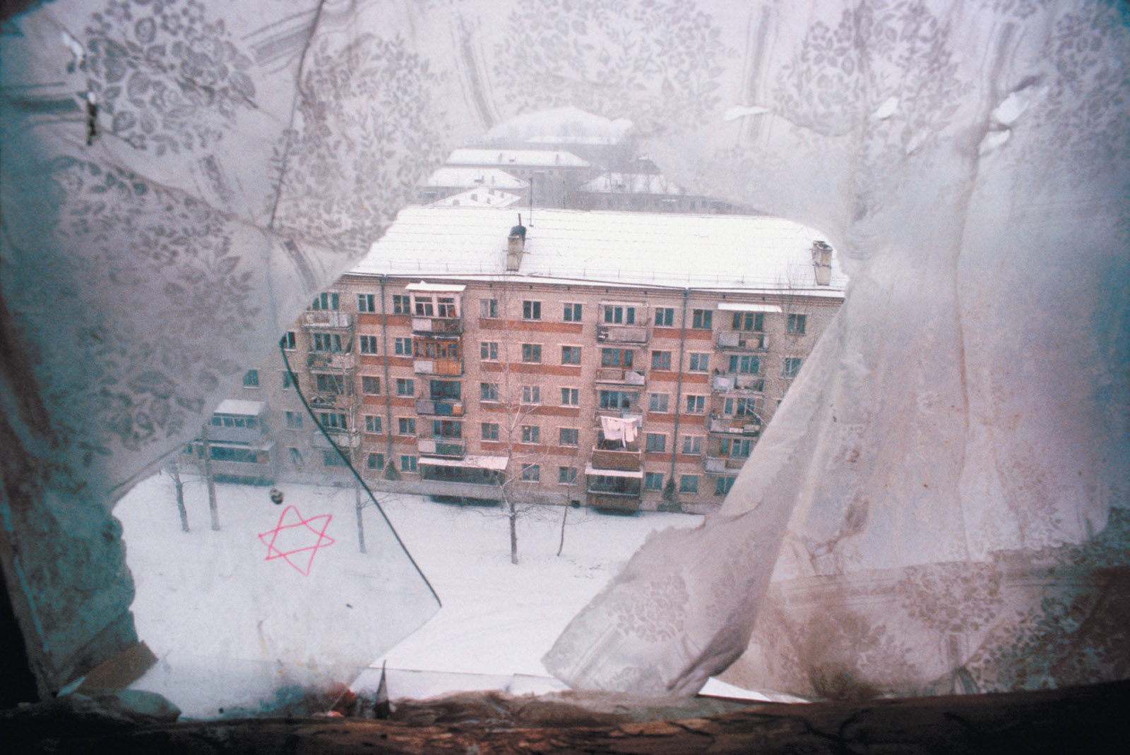A Star of David on a broken apartment block window, Birobidzhan, Jewish Autonomous Region, Russia, 1999