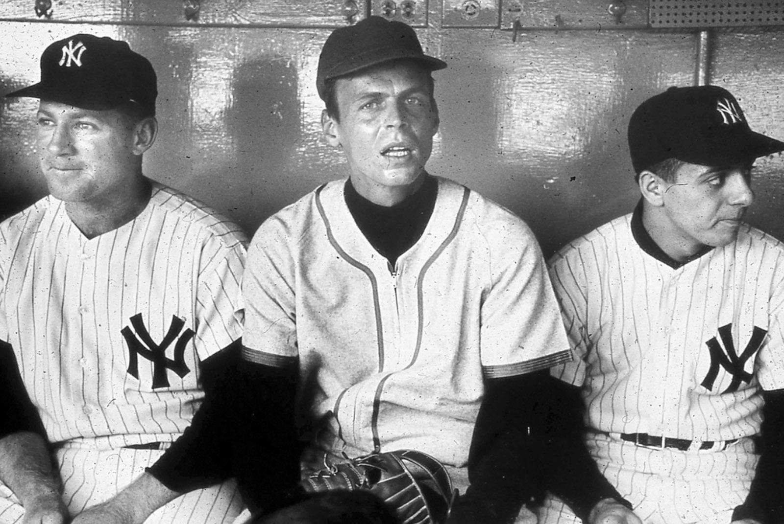 'Flanked by Whitey Ford and the Yankee batboy just after my ordeal,' Plimpton writes in Out of My League. 'The photograph was snapped as I dropped down between them—providing an accurate study of shock, in my case, and justified amusement from the ballplayers. They were not at all displeased that their profession had treated me as roughly as it had.'