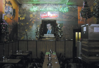 A portrait of Syrian President Bashar al-Assad in a café in Damascus at the time of the US-led invasion of Iraq, March 2003