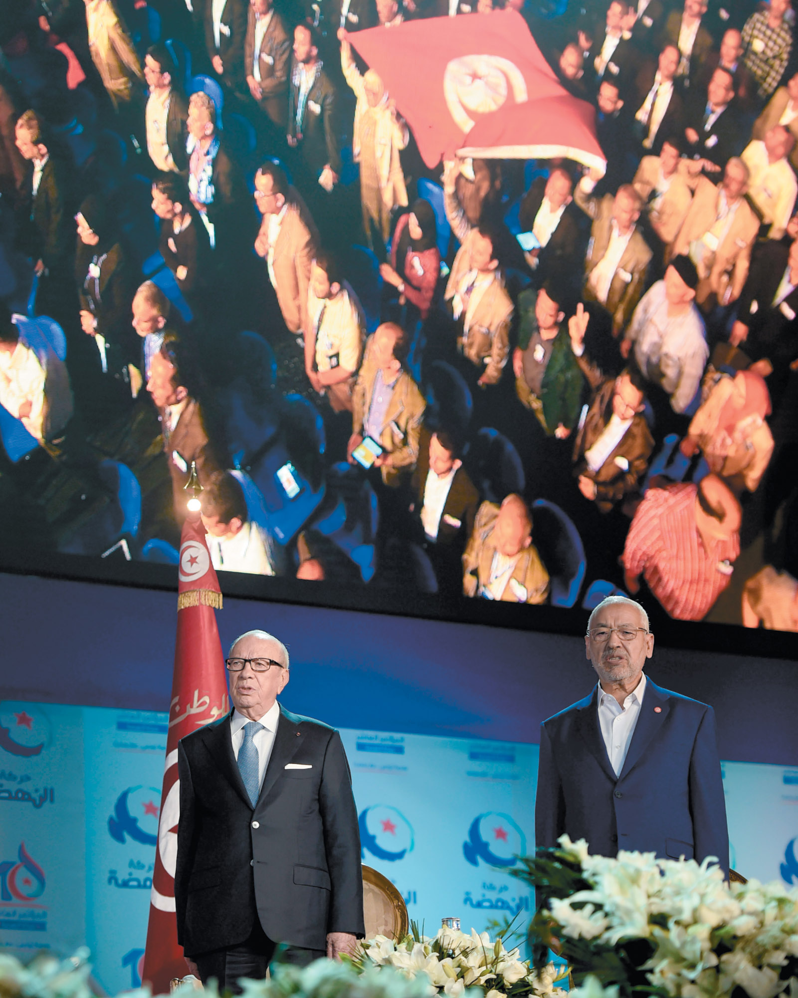 Tunisian President Beji Caid Essebsi and Islamist Ennahda Party leader Rachid Ghannouchi at the opening ceremony of Ennahda's congress, Tunis, May 2016