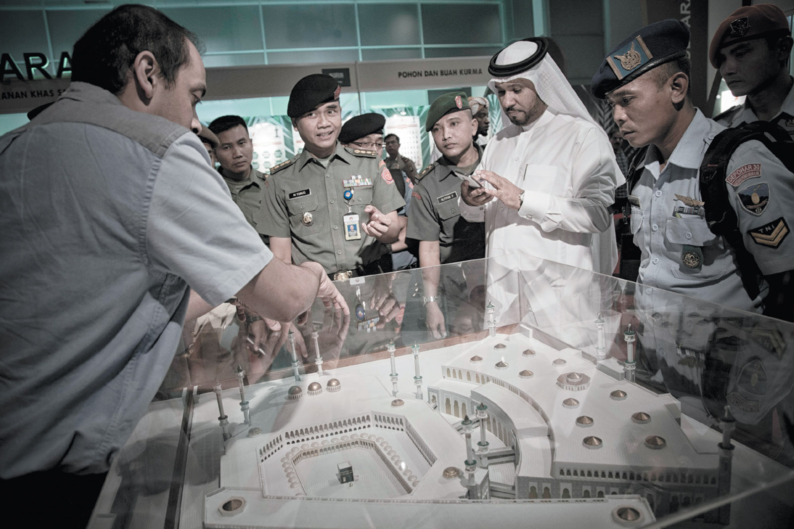 A Saudi official explaining a maquette of the mosque at Mecca to members of the Indonesian military at  a Saudi-sponsored festival in Jakarta, March 2016