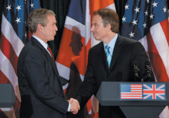 George W. Bush and Tony Blair at a joint press conference at Hillsborough Castle, near Belfast, Northern Ireland, April 2003