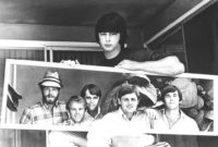 Mike Love, Al Jardine, Carl Wilson, Bruce Johnston, and Dennis Wilson of the Beach Boys, reflected in a mirror held by their producer and founder Brian Wilson, circa 1967
