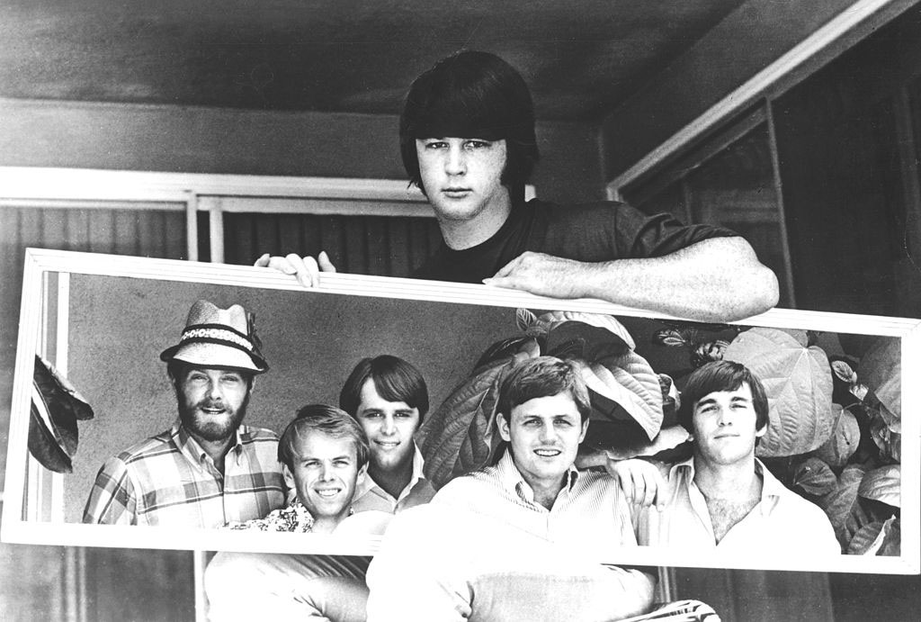 Mike Love, Al Jardine, Carl Wilson, Bruce Johnston, and Dennis Wilson, reflected in a mirror held by Brian Wilson, circa 1967