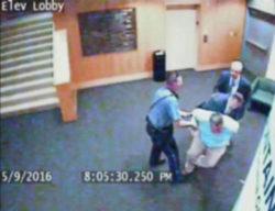 Video footage of library staff member Steve Woolfolk being arrested
