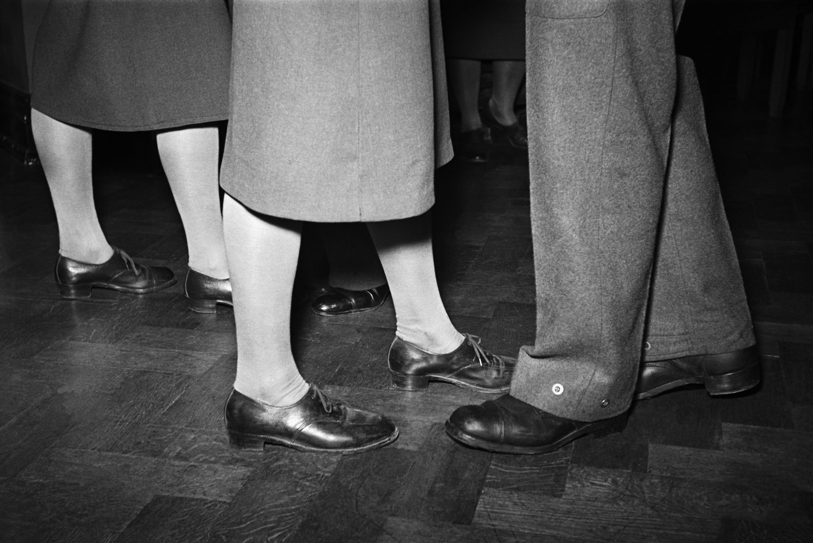 Utility footwear worn on a wartime evening out, London, 1940