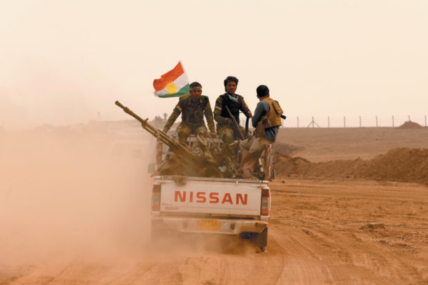 Kurdish peshmerga fighters at the front line during a battle with Islamic State militants near Mosul, Iraq, October 2016