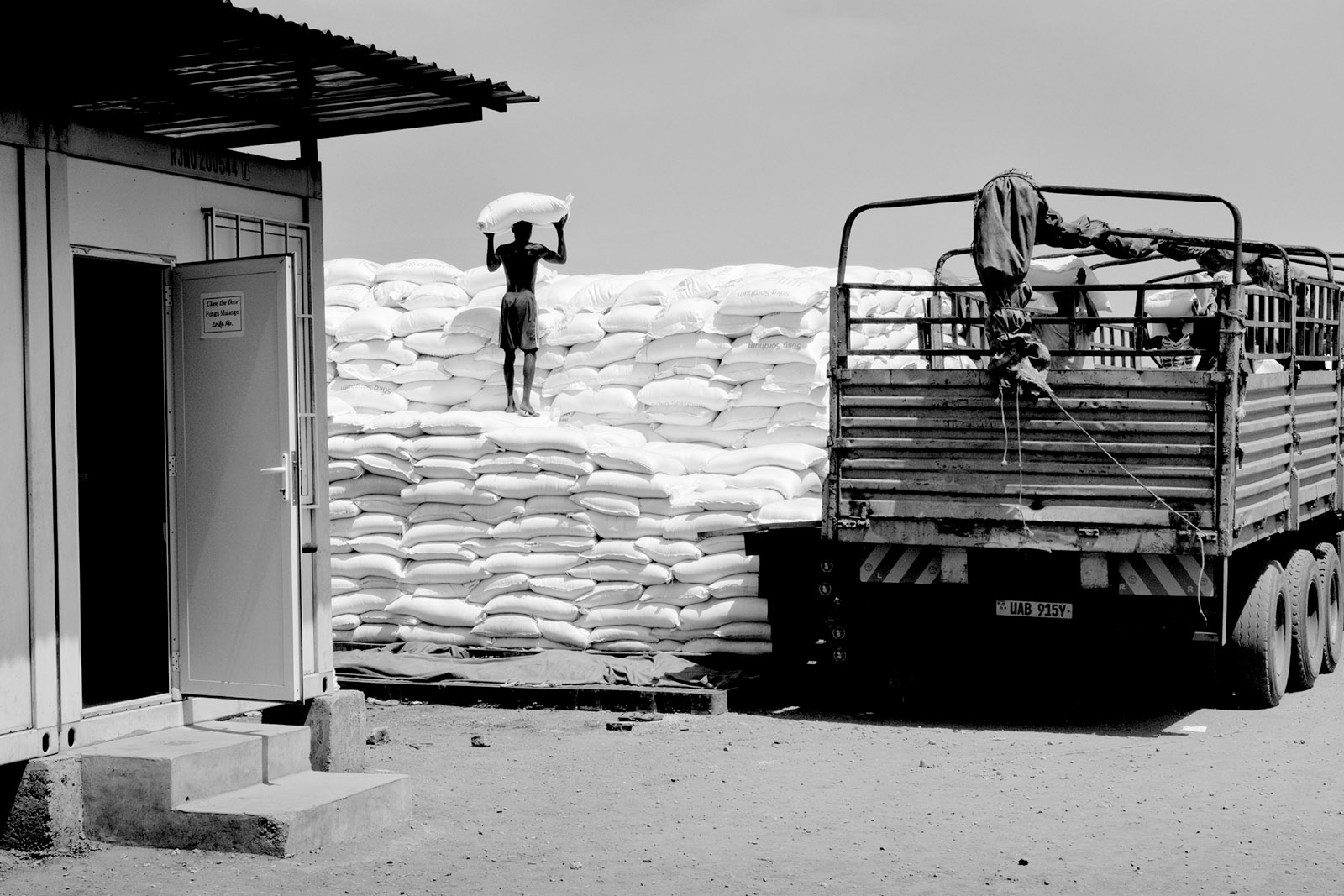 A worker stacking bags of grain at the World Food Programme warehouses in Juba, South Sudan, March 2016