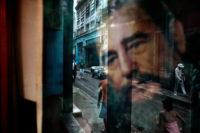 Reflection of Fidel Castro on a window in a working-class neighborhood, Havana, Cuba, 2012