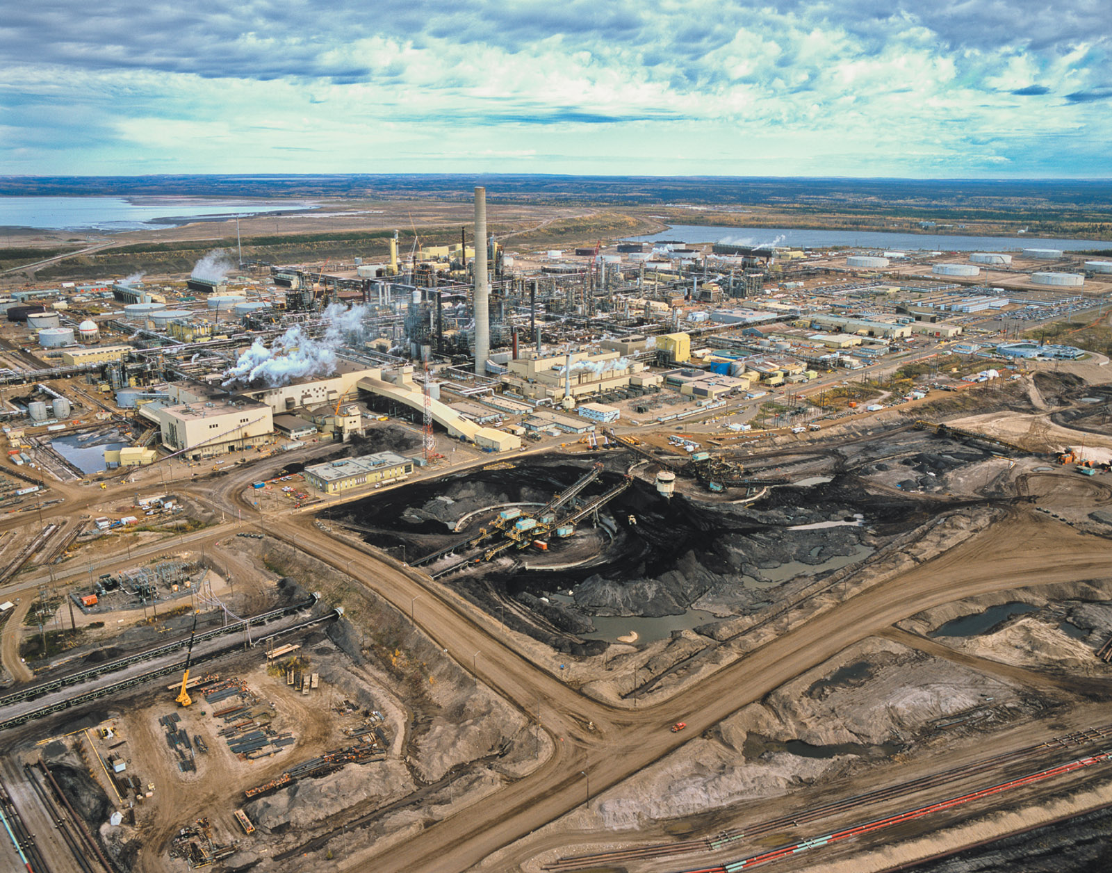 A plant owned by Syncrude, a joint venture of ExxonMobil's Canadian subsidiary Imperial Oil, which processes oil from the tar sands of northern Alberta, Canada's biggest source of carbon emissions and the US's largest source of imported oil; photograph by Garth Lenz from his traveling exhibition 'The True Cost of Oil'
