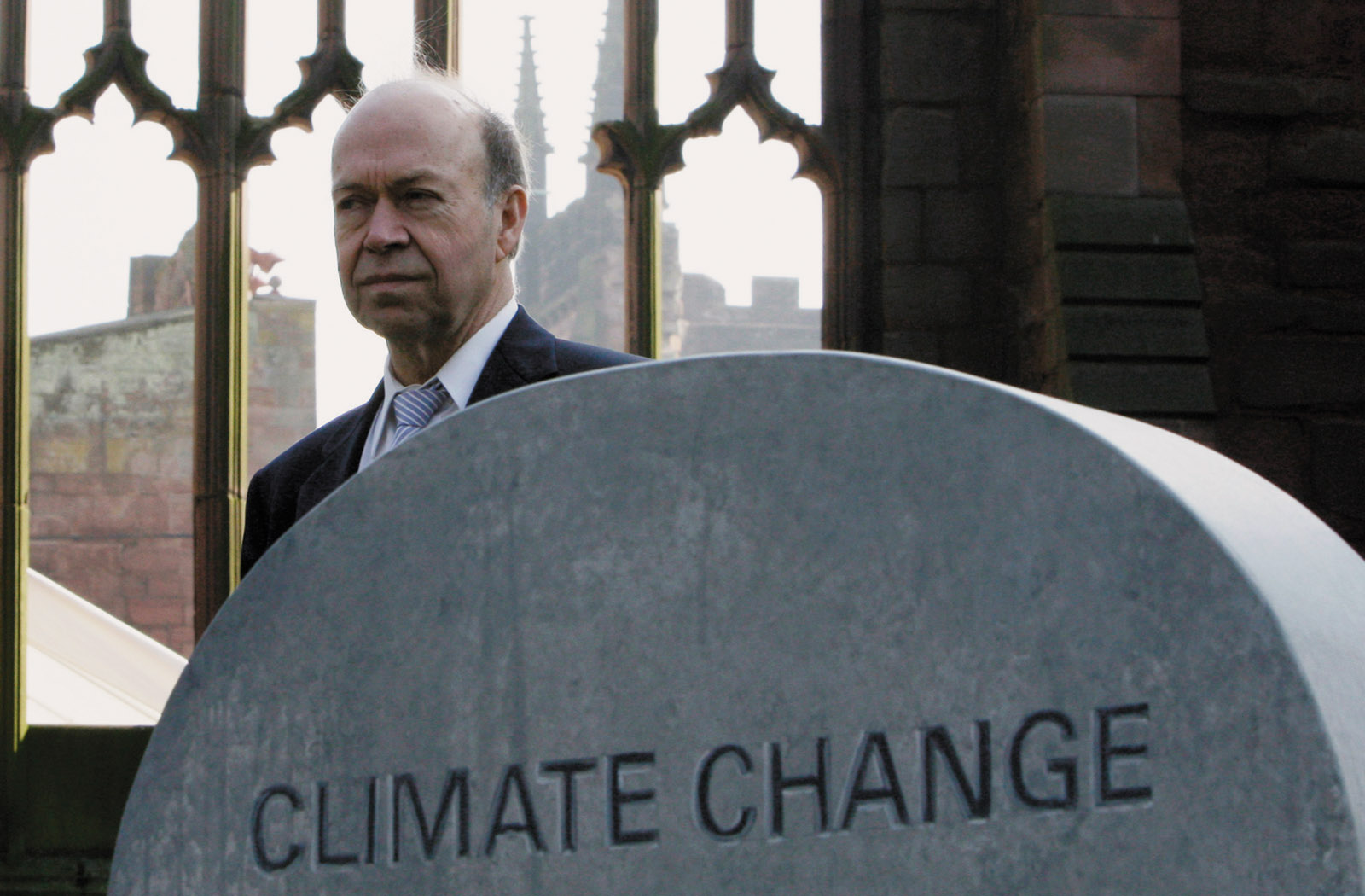 Climate scientist James Hansen at a mock gravestone declaring 'Climate Change: A Matter of Life and Death,' Coventry, England, March 2009