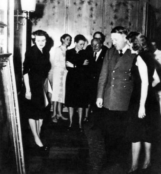 Adolf Hitler with Eva Braun at his birthday party, April 1942