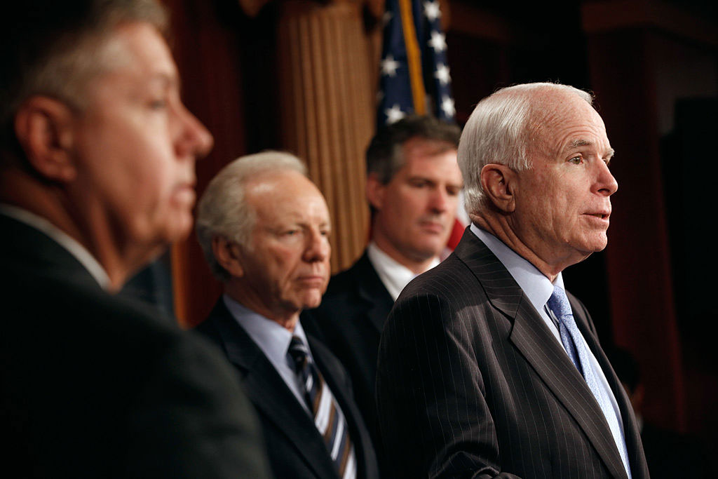 Senator John McCain (right) with fellow senators Lindsey Graham, Joe Lieberman, and Scott Brown, introducing legislation to refine the Detainee Treatment Act of 2005, Washington, DC, March 10, 2011