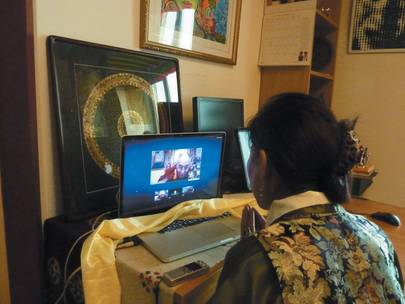 Tsering Woeser meeting the Dalai Lama over the Internet during a video conversation organized by her husband, the Chinese writer Wang Lixiong, and the Chinese human rights lawyers Teng Biao and Jiang Tianyong, Beijing, January 2011