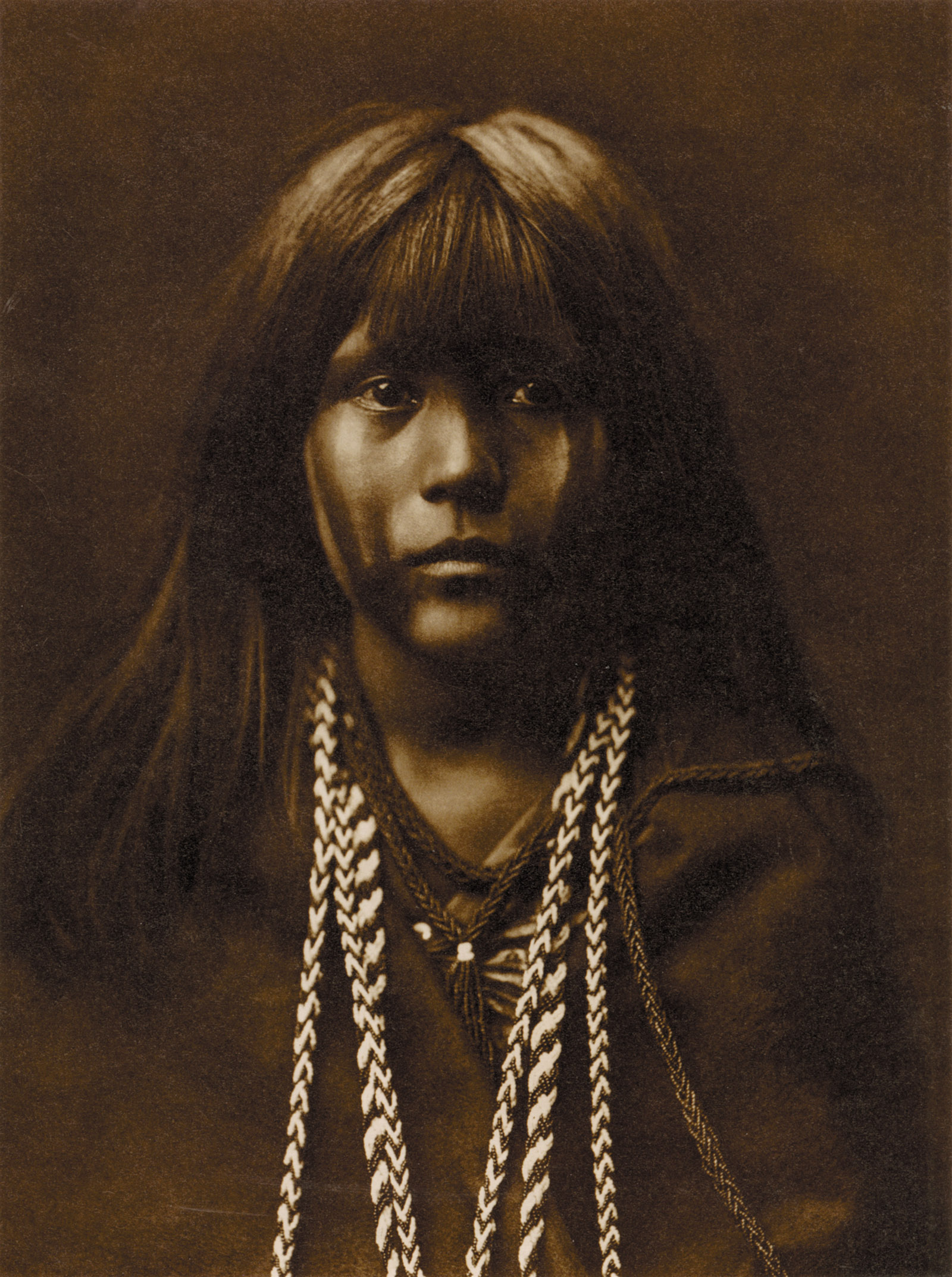 Edward S. Curtis: Mosa—Mohave, 1903/1907; from Edward S. Curtis: One Hundred Masterworks. The book is by Christopher Cardozo, with contributions by A. D. Coleman, Louise Erdrich, and others. It is published by Delmonico/Prestel and the Foundation for the Exhibition of Photography.