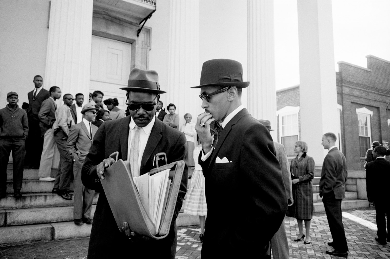 Reverend Wyatt T. Walker (right), executive director of the Southern Christian Leadership Conference and chief of staff to Martin Luther King Jr., with a lawyer at the courthouse in Petersburg, Virginia, to argue for the rights of nonviolent demonstrators against a segregationist trespassing ordinance aimed at thwarting sit-ins, 1960