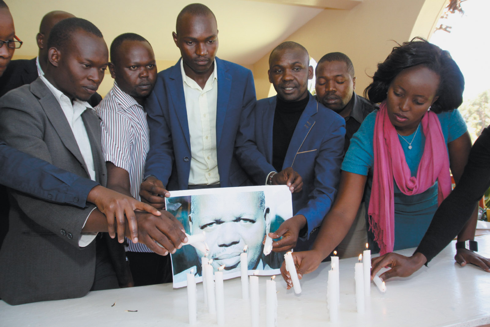 Journalists lighting candles in memory of newspaper editor John Kituyi on World Press Freedom Day, Eldoret, Kenya, May 2016. Kituyi was killed the year before while preparing to publish the results of an investigation that, according to Alan Rusbridger, 'could have embarrassed leading figures in Kenya's national government.'