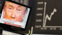 Donald Trump is pictured onscreen in front of the German share price index at the stock exchange in Frankfurt, Germany, November 9, 2016