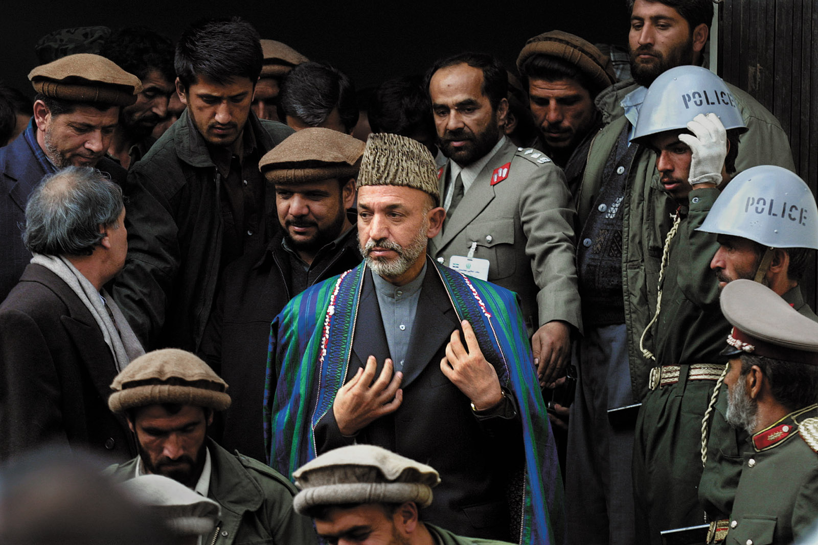 Hamid Karzai leaving the Interior Ministry after being sworn in as prime minister of Afghanistan's interim government, Kabul, December 2001; photograph by Paula Bronstein from her book Afghanistan: Between Hope and Fear, just published by University of Texas Press