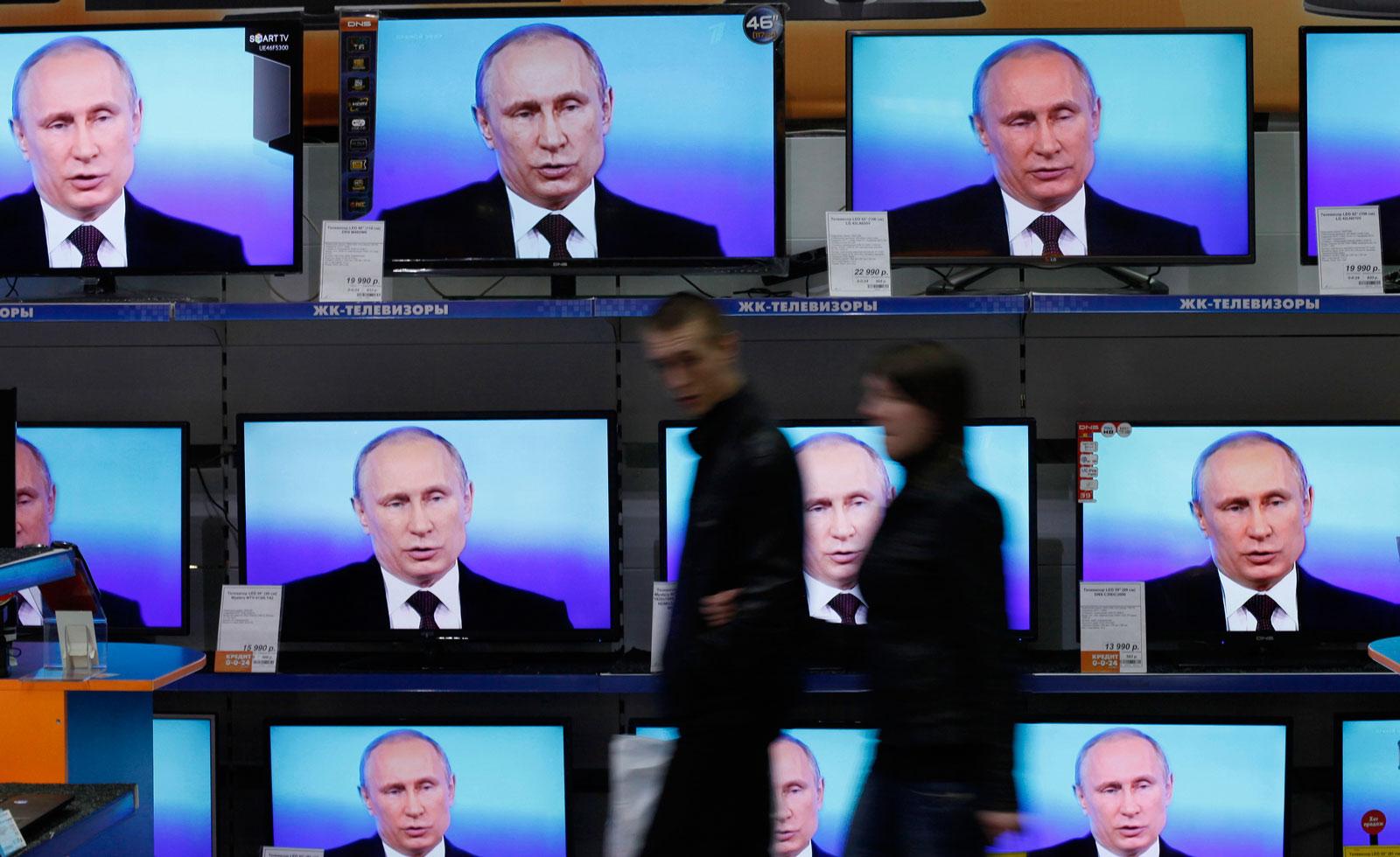 Vladimir Putin on television screens in Krasnoyarsk, Russia, April 17, 2014