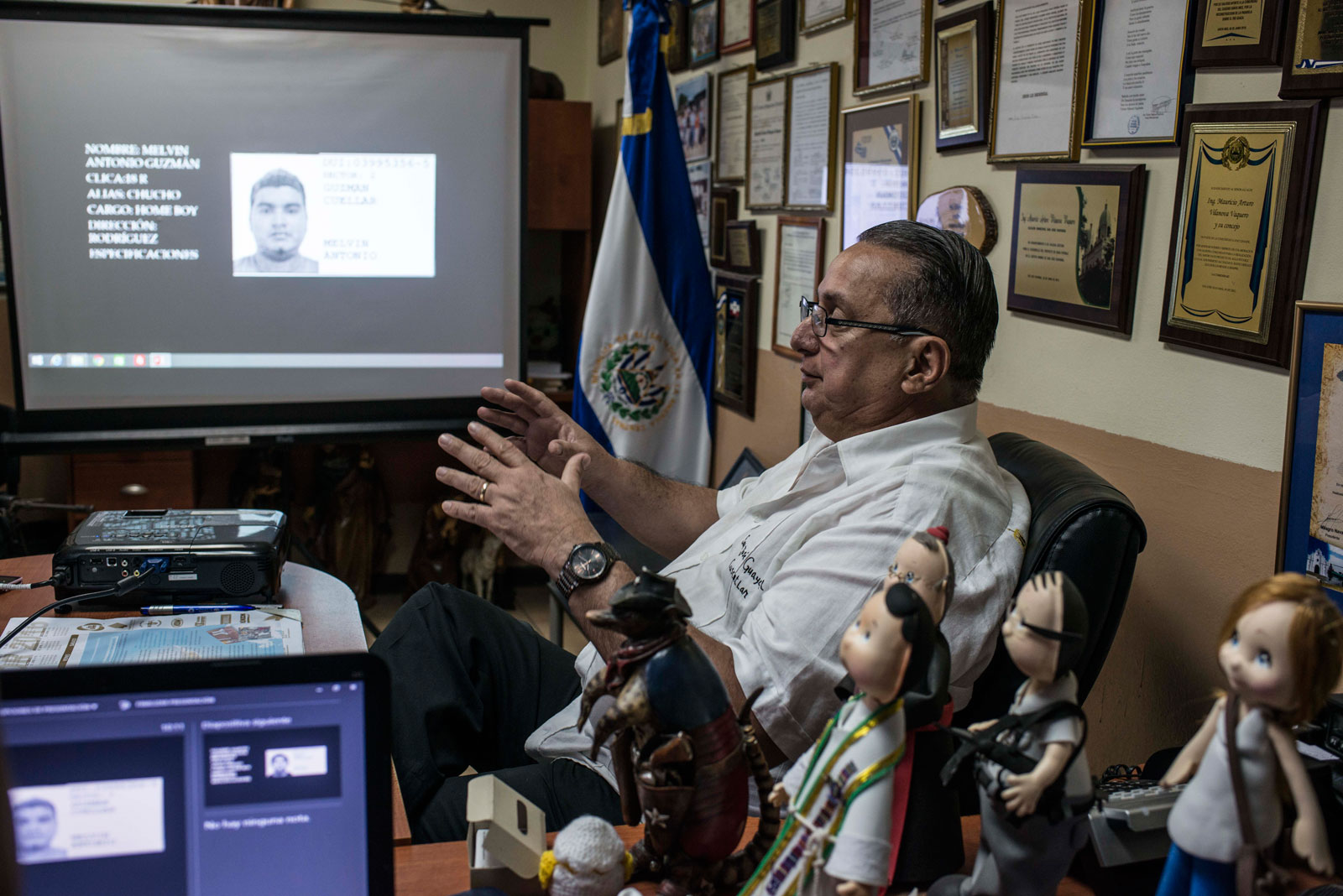 Mayor Mauricio Vilanova, showing pictures of suspected local gang members, San José Guayabal, El Salvador, August 21, 2016
