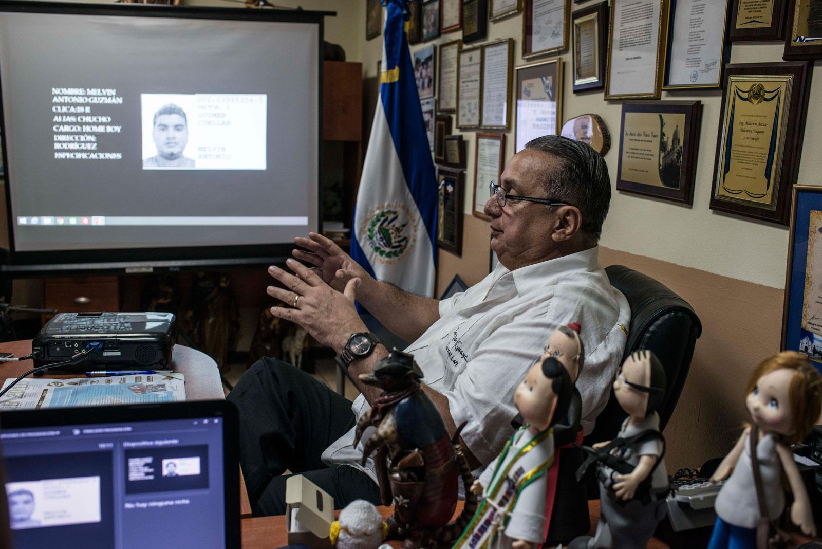 Mayor Mauricio Vilanova, showing pictures of suspected local gang members, San José Guayabal, El Salvador, August 21, 2016
