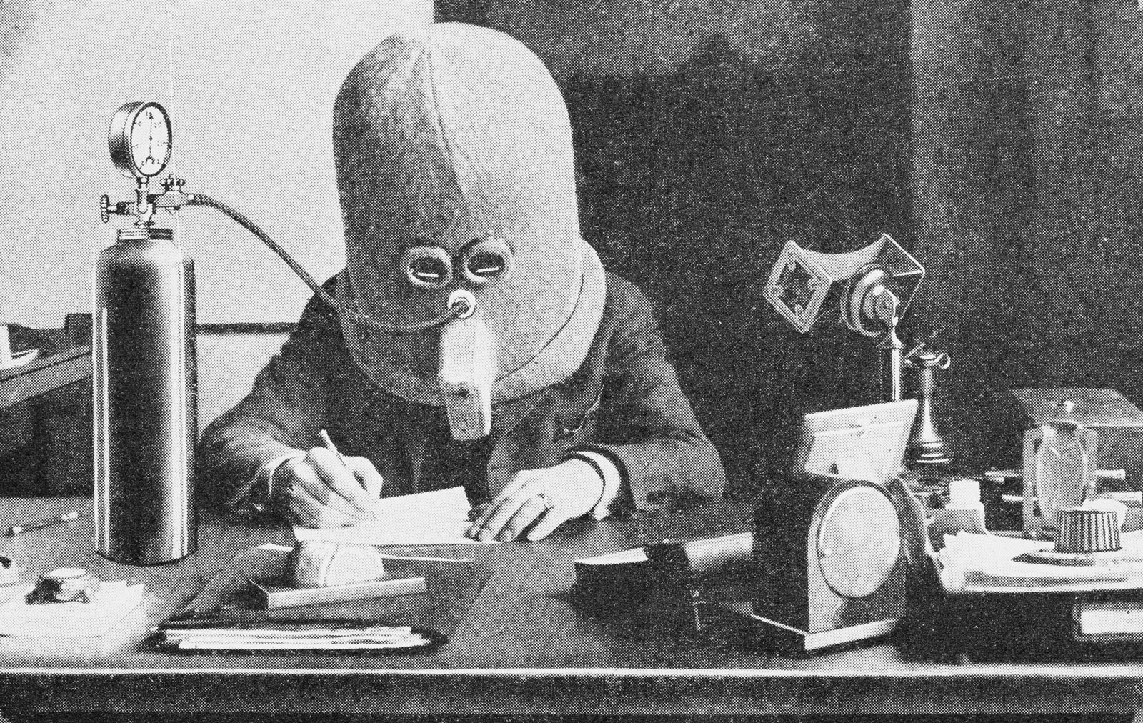 Hugo Gernsback wearing his Isolator, which eliminates external noises for concentration, from Science and Invention, July, 1925