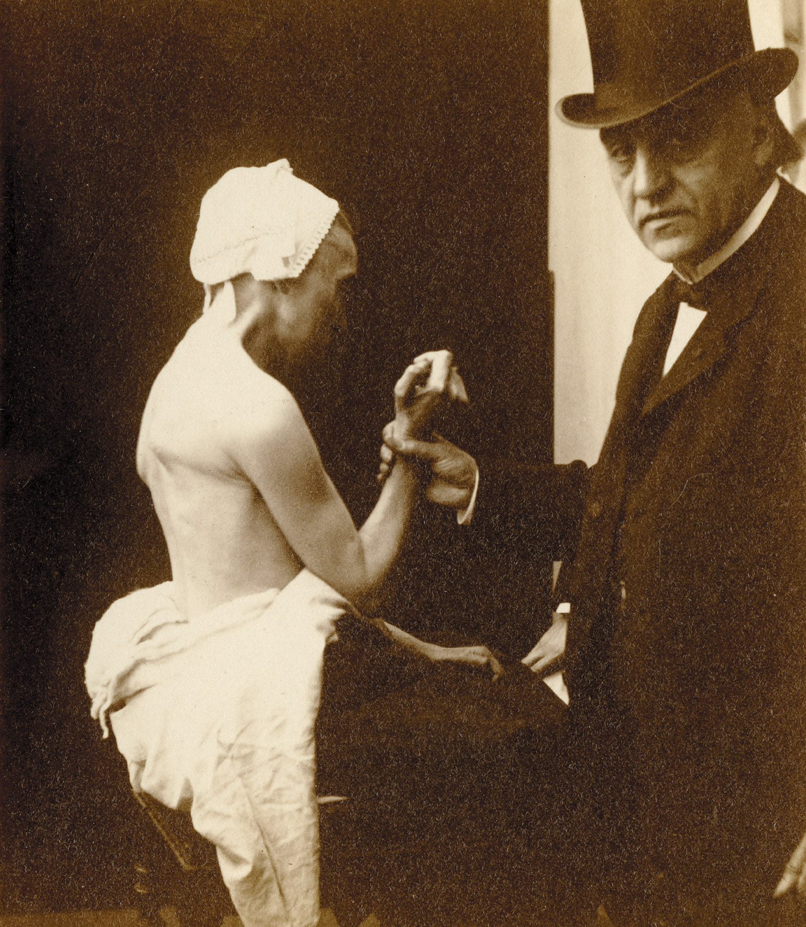 The neurologist Jean-Martin Charcot holding the arm of a female patient suffering from locomotor ataxia, Hôpital Salpêtrière, Paris, circa 1885