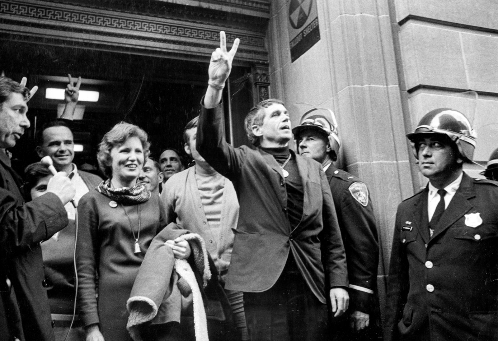 Catonsville Nine members Mary Moylan and Daniel Berrigan leaving the Baltimore federal courthouse at the time of their trial for burning draft files to protest the Vietnam War, October 1968