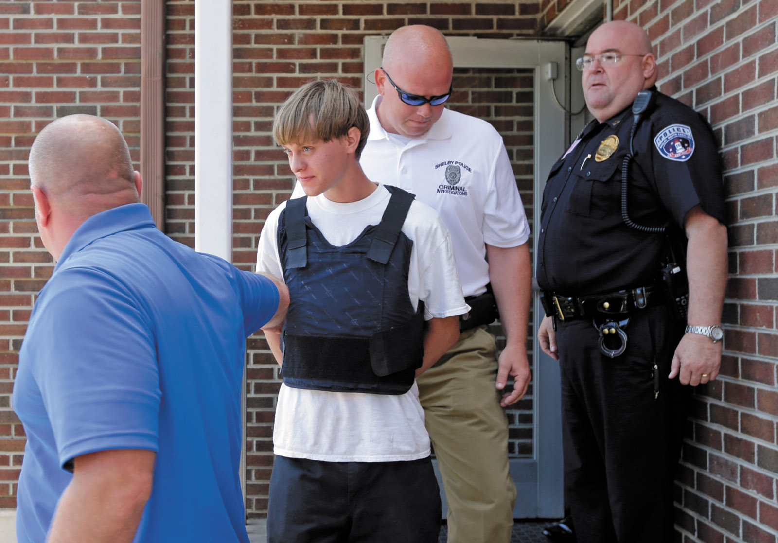 Dylann Roof being escorted from the Shelby Police Department after his arrest, Shelby, North Carolina, June 2015