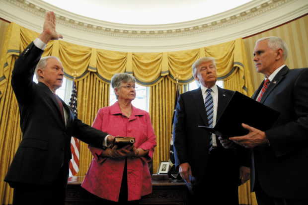 Jeff Sessions being sworn in as US attorney general, with his wife Mary Sessions, President Donald Trump, and Vice President Mike Pence, February 2017